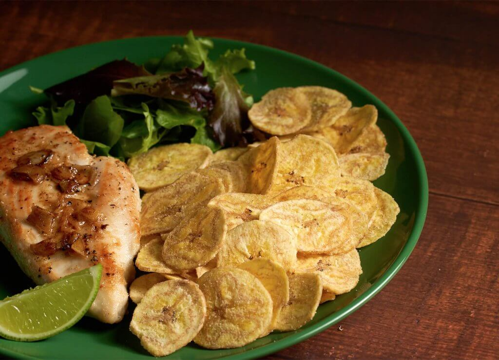Natura chips on a plate with salmon